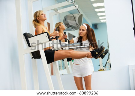 portrait of girl and her trainer working out on VKR - stock photo