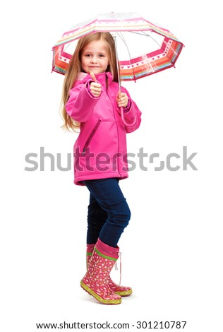 Portrait of girl child wearing pink clothes with umbrella. Isolated white studio background. - stock photo