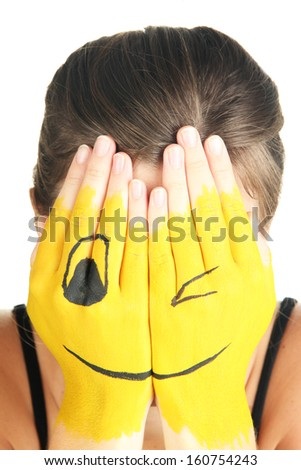 Portrait of girl hiding her face under a mask isolated on white - stock photo