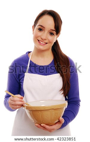Portrait of girl holding mixing bowl - stock photo
