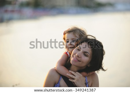 portrait of girl hugging her mother  - stock photo