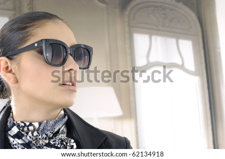 Portrait of girl in fashion dress wearing sunglasses - stock photo