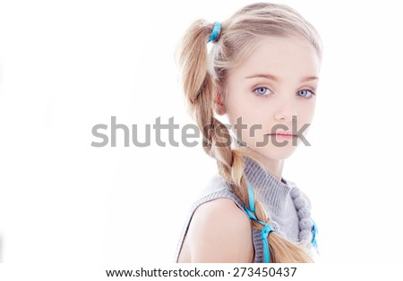 Portrait of girl in grey dress. Isolated on white - stock photo