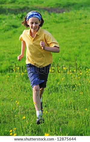 portrait of girl outdoors running - stock photo