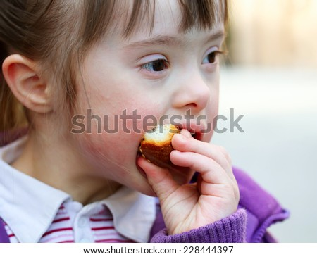 Portrait of girl that eating baguette - stock photo