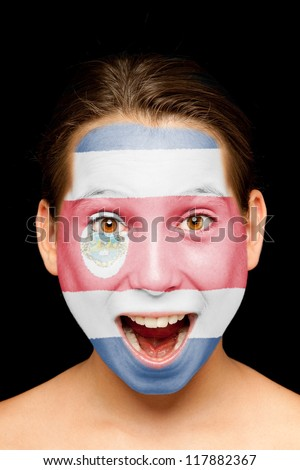 portrait of girl with Costa Rican flag painted on her face - stock photo