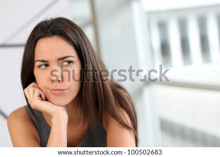 Portrait of girl with doubtful look on her face - stock photo