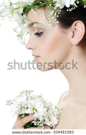 Portrait of girl with flowers in hair - stock photo
