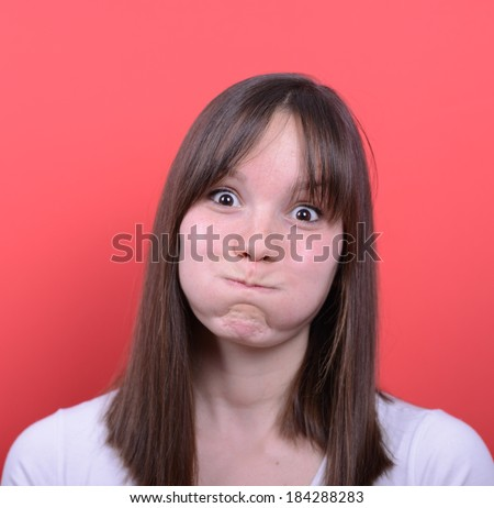 Portrait of girl with funny face - stock photo