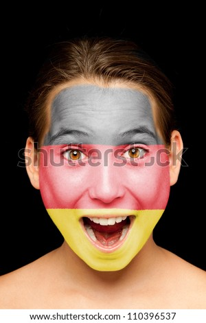 portrait of girl with german flag painted on her face - stock photo