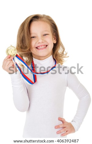 Portrait of girl with golden medal on a gray background - stock photo