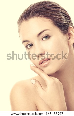Portrait of girl with the ideal skin, isolated on a white background - stock photo
