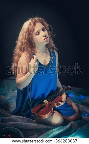 Portrait of girl with violin - stock photo