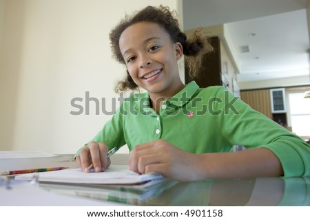 Portrait of girl working on homework - stock photo