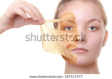 Portrait of girl young woman in orange facial peel off mask isolated on white. Peeling. Beauty and body skin care. Studio shot. - stock photo