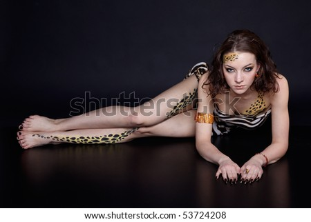 portrait of girll in cat make-up and bodyart - stock photo