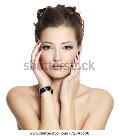 Portrait of  glamour sexy young woman with black nails and  eye make-up, posing on white background - stock photo