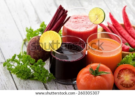 portrait of glasses with vegetable juices. beetroot juice, tomato juice, chili juice - stock photo