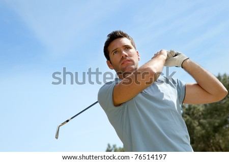Portrait of golfer playing in summertime - stock photo