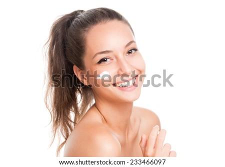 Portrait of gorgeous brunette using body milk. - stock photo