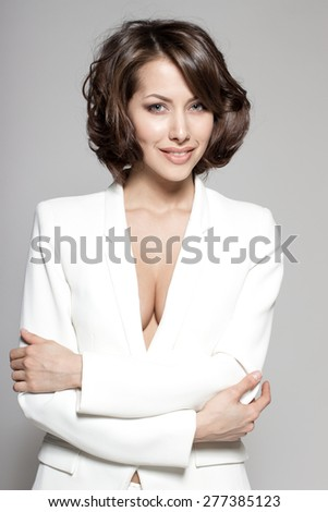 Portrait of gorgeous young caucasian attractive sexy business woman or secretary wearing white suit - stock photo