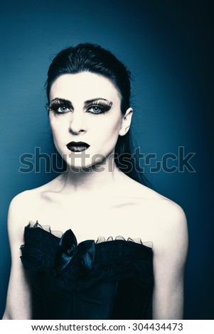 Portrait of gothic style sexy woman - stock photo