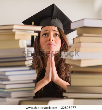 Portrait Of Graduated Woman Praying, Indoors - stock photo