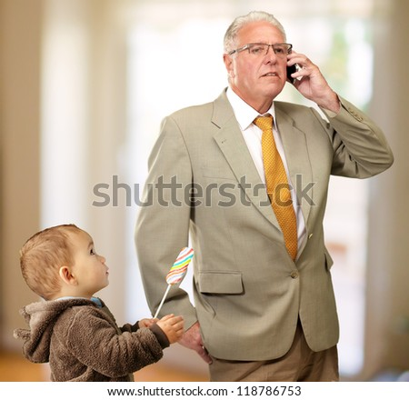 Portrait Of Grandfather And Grand Son, Indoor - stock photo