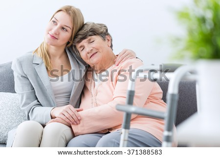 Portrait of grandmother and granddaughter being friends - stock photo
