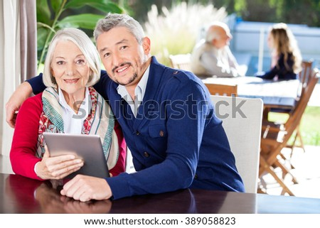 Portrait Of Grandmother And Grandson Using Digital Tablet - stock photo