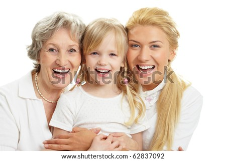 Portrait of grandmother with adult daughter and grandchild laughing - stock photo