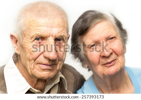 portrait of grandparents on a white background - stock photo