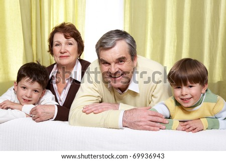 Portrait of grandparents with two their grandsons - stock photo