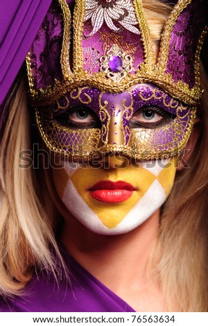 Portrait of grave woman in carnival violet mask - stock photo