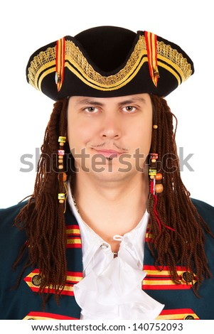 Portrait of grinning man wearing pirate costume and cocked hat. Isolated on white  - stock photo