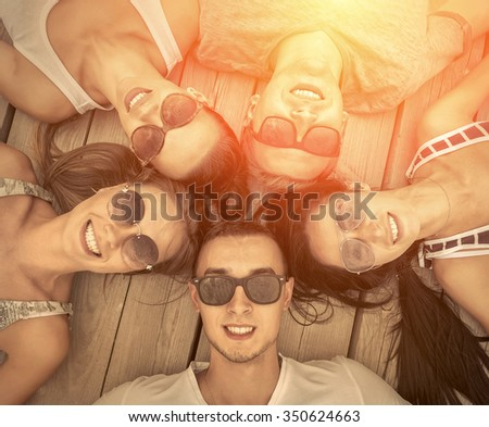 Portrait of group friends on the wooden background. - stock photo