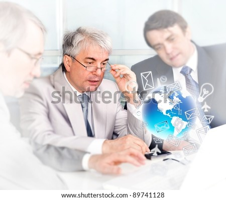 Portrait of group of businessmen at the computer. Office background. - stock photo