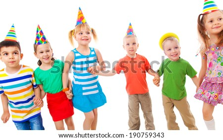 Portrait of group of children at birthday party - stock photo