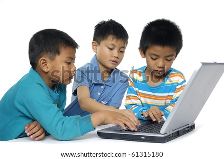 Portrait of group of children working on the laptop - stock photo