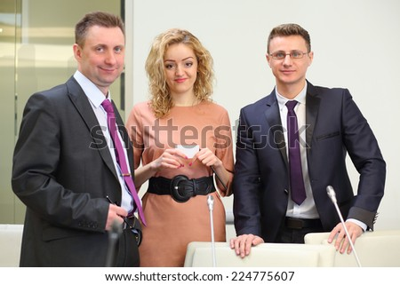 Portrait of group of happy business people: two men and a woman - stock photo