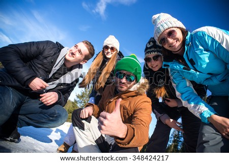 Portrait of Group of teenagers have a good time in winter. - stock photo