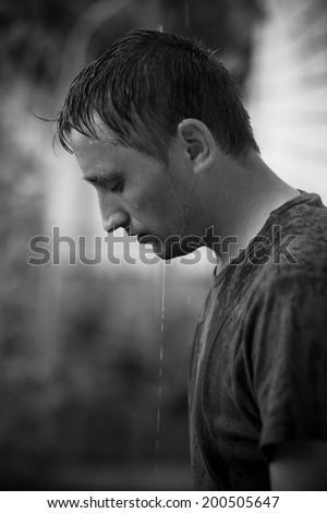 portrait of guy after rain - stock photo