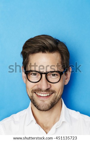 Portrait of guy in glasses, studio - stock photo
