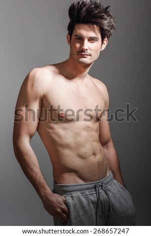 Portrait of half naked sexy body of muscular athletic man. Studio shot  - stock photo