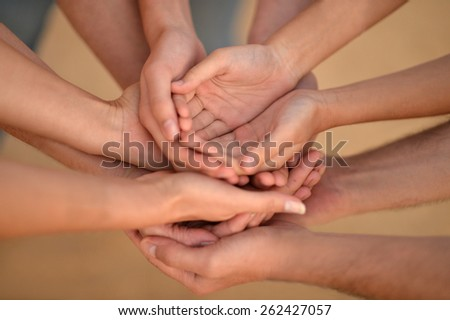 Portrait of hands of a family together closeup - stock photo