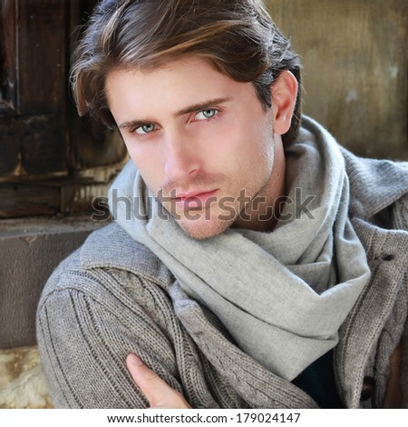 portrait of handsome appealing guy near window - stock photo