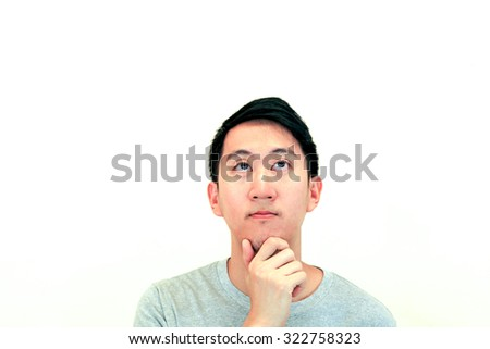 Portrait of Handsome Asian man thinking and looking up on isolated white background with copy space. Human face expressions, emotions, feelings, body language, perception - stock photo