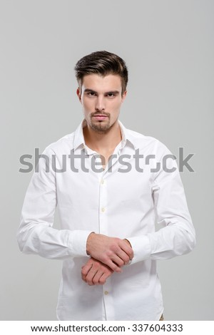 Portrait of handsome attractive charming confident young man in white shirt - stock photo