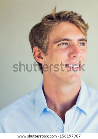 Portrait of Handsome Attractive Young Man Smiling - stock photo