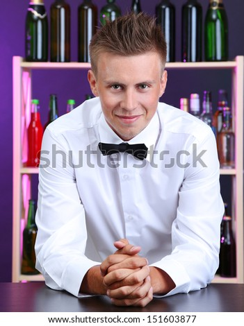 Portrait of handsome barman at bar - stock photo